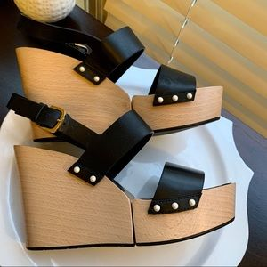 Authentic Chanel wedge with pearl embellishments.